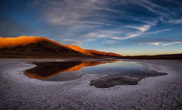 Intense blue lagoons shimmer in the Atacama desert in Chili