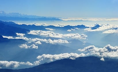 Picture of the misty mountains in Nepal taken from the sky