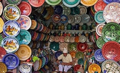 Picture of brightly colored ceramics and art displayed in the market at Marrakech Morocco