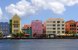 Colorful buildings line the waterway at this lively town in Curacao