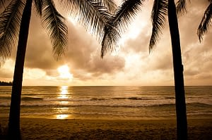 Picture of the sun setting over the beach in Phuket Thailand