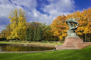 A one-of-a-kind stone statue flanks the lake at Lazienki in Warsaw Poland