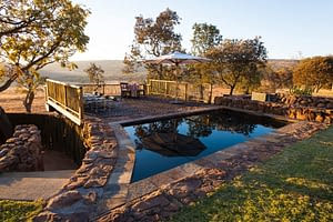 Picture of relaxing pool, spa and deck set in the African wilderness