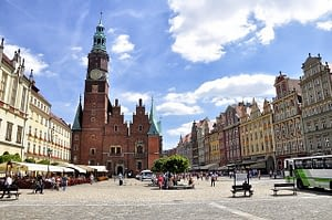 Colorful character buildings line the cobbled streets in Wroclaw Poland