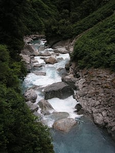 Picture of the water tumbling over the Gates of Haast in New Zealand