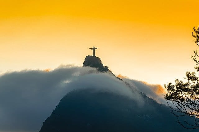 Picture of Christ the Redeemer statue at the top of the cloud covered mountain